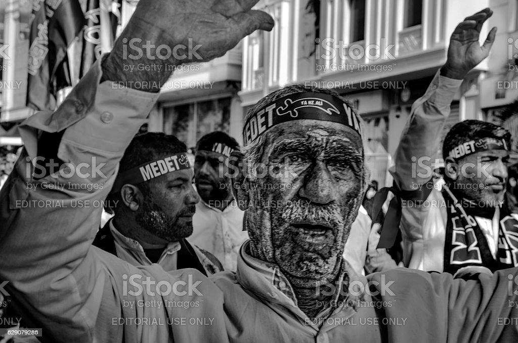 Shia Muslim men shout Islamic slogans Ashura procession stock photo