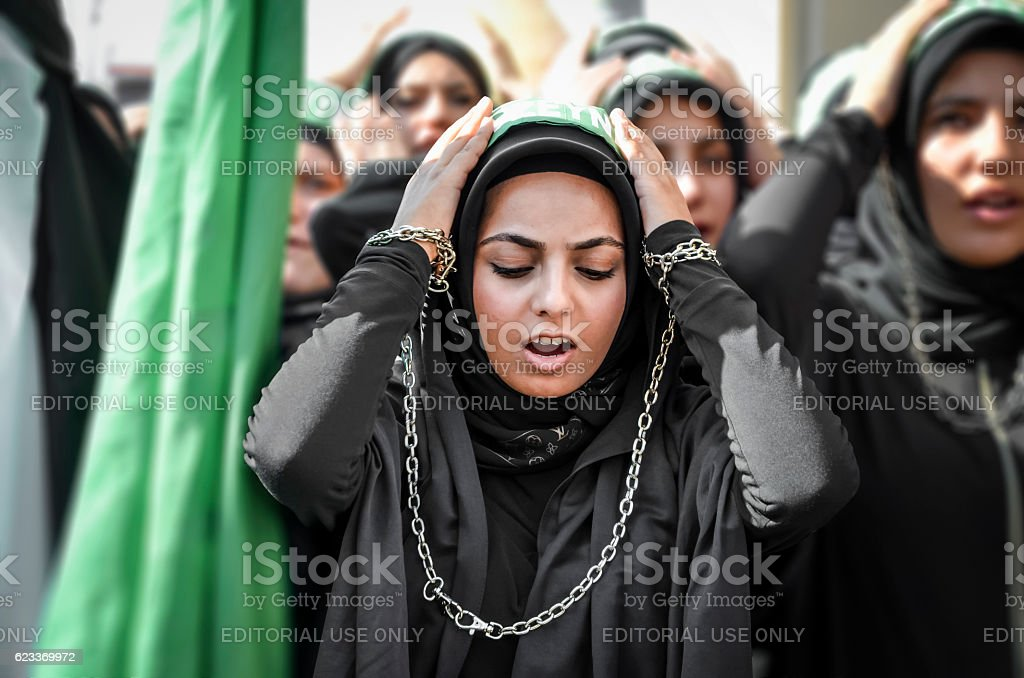 Shia Muslim women shout Islamic slogans Ashura procession stock photo