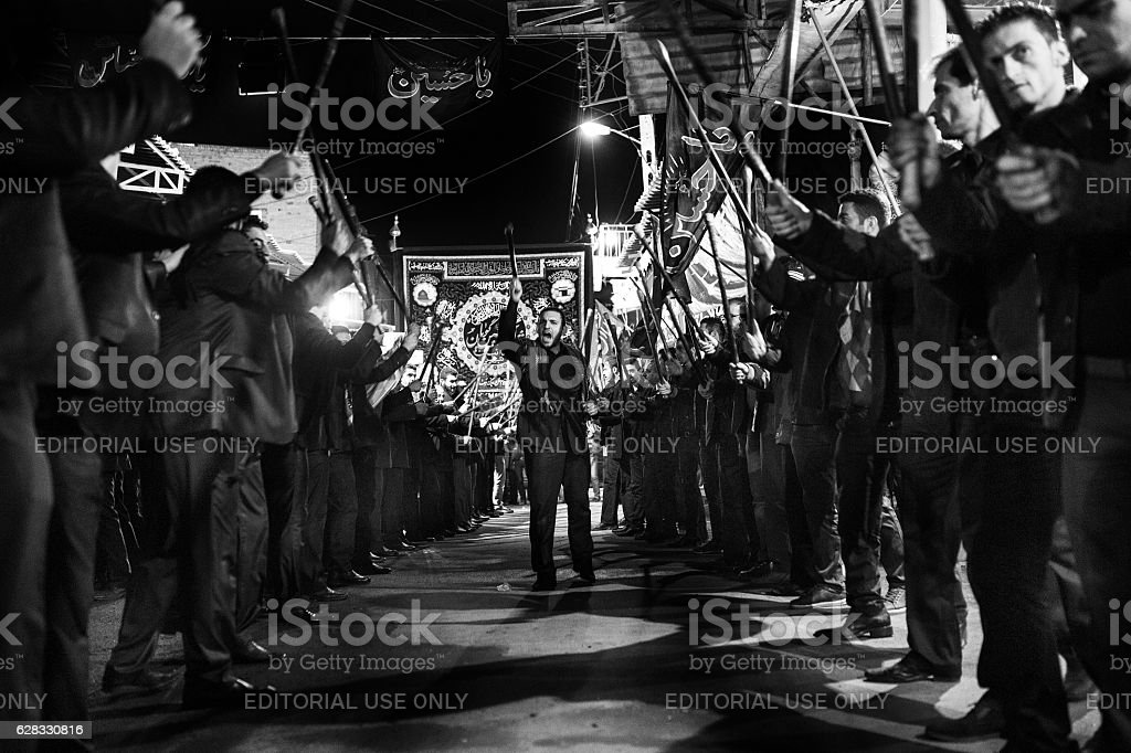 Shia muslums pray in the mourning of Ashura. stock photo