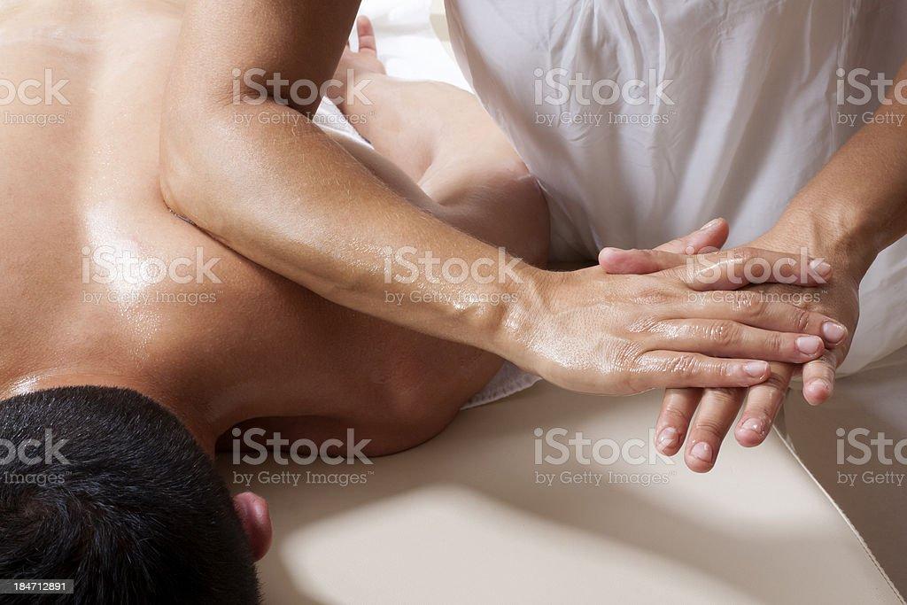 Shiatsu massage of Trapeziues stock photo