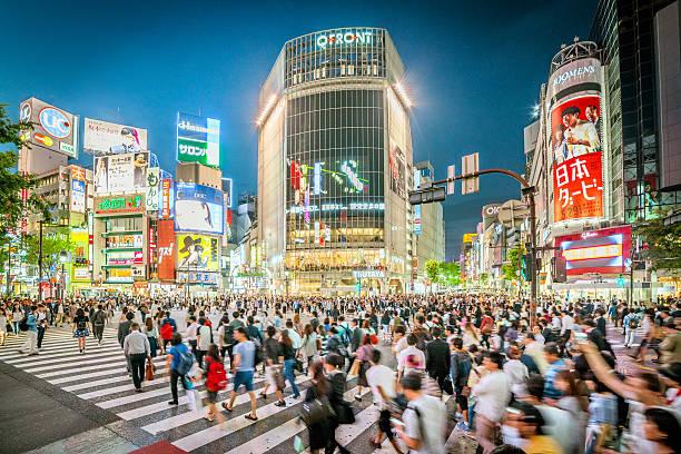 shibuya crossing in tokyo, japan - shinjuku ward stock photos and pictures