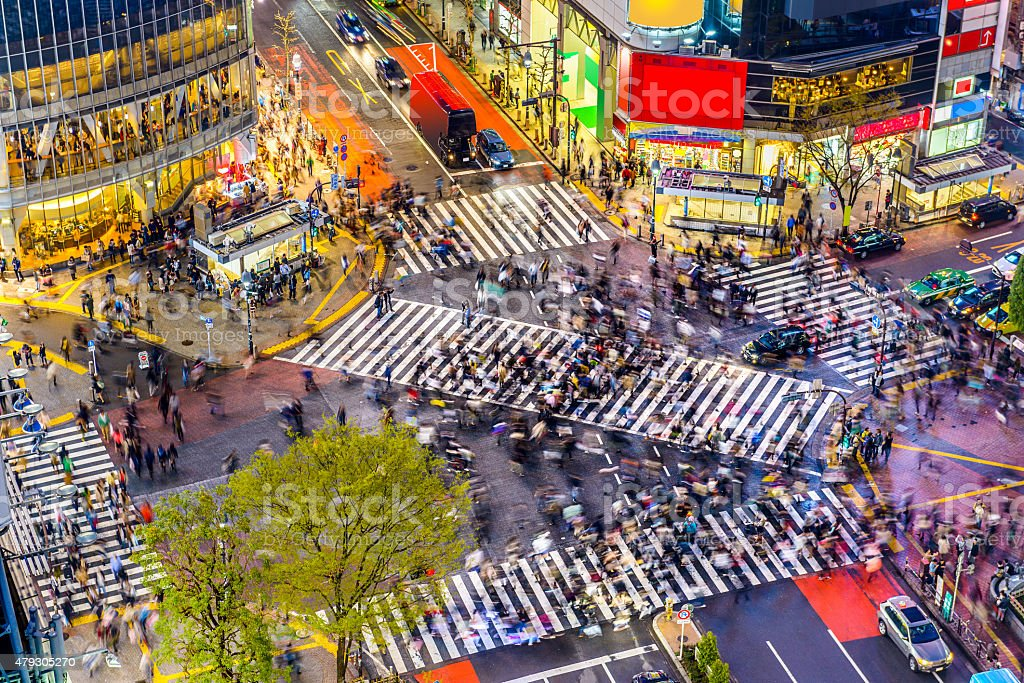 Shibuya Crossing in Tokyo Tokyo, Japan view of Shibuya Crossing, one of the busiest crosswalks in the world. 2015 Stock Photo