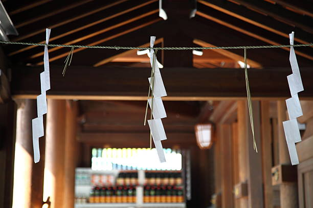 SHIDE-zigzag-shaped paper streamer Taken at a Shrine in Tokyo. shrine stock pictures, royalty-free photos & images