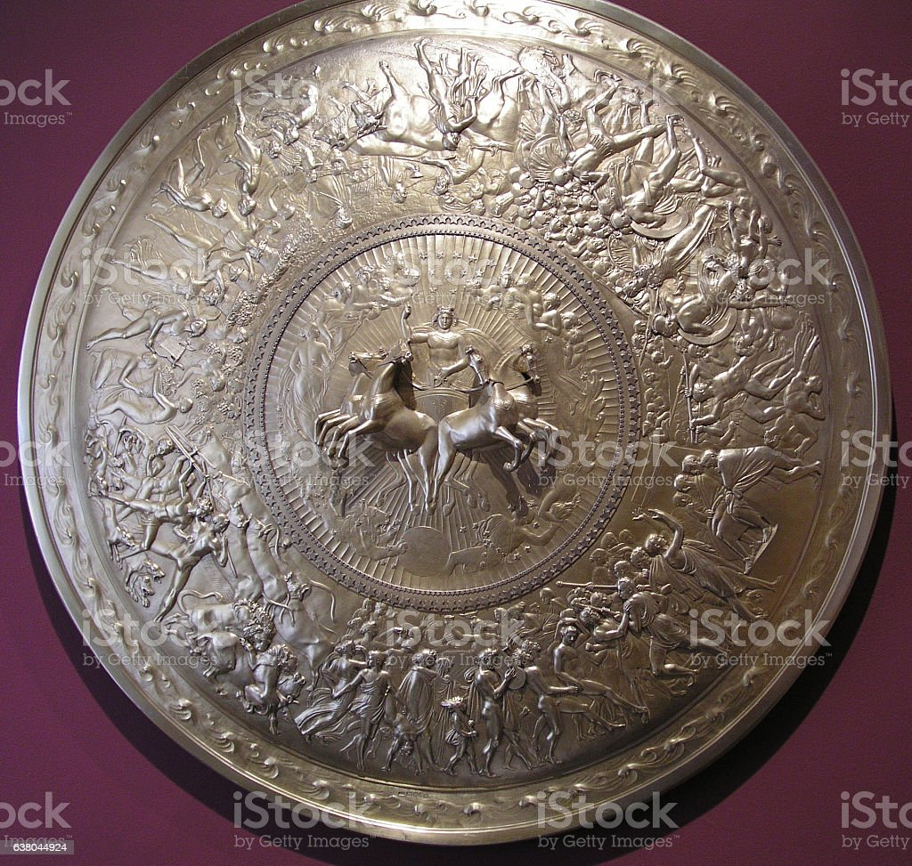 Shield breast plate with horses and chariots stock photo