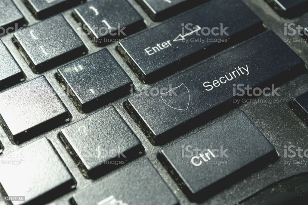 Shield icon on keyboard. Cyber security concept stock photo