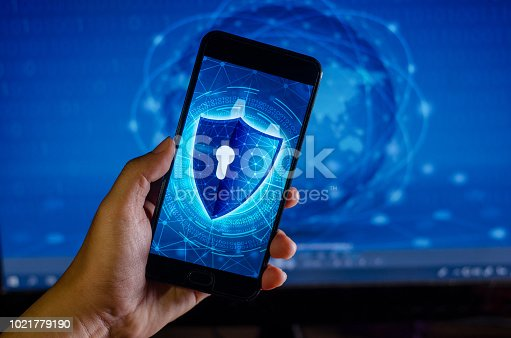 906892336 istock photo Shield Internet phone Smartphone is protected from hacker attacks, Firewall Business people press the protected phone on the internet. space put message 1021779190