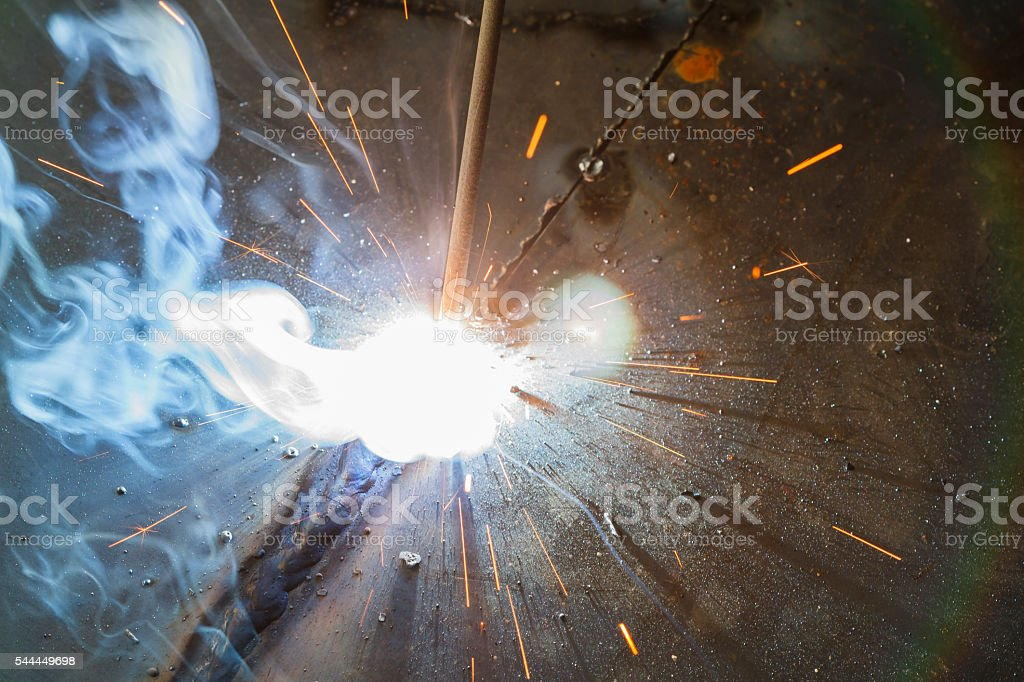 SMAW – Shielded metal arc welding and welding fumes at spark area on...