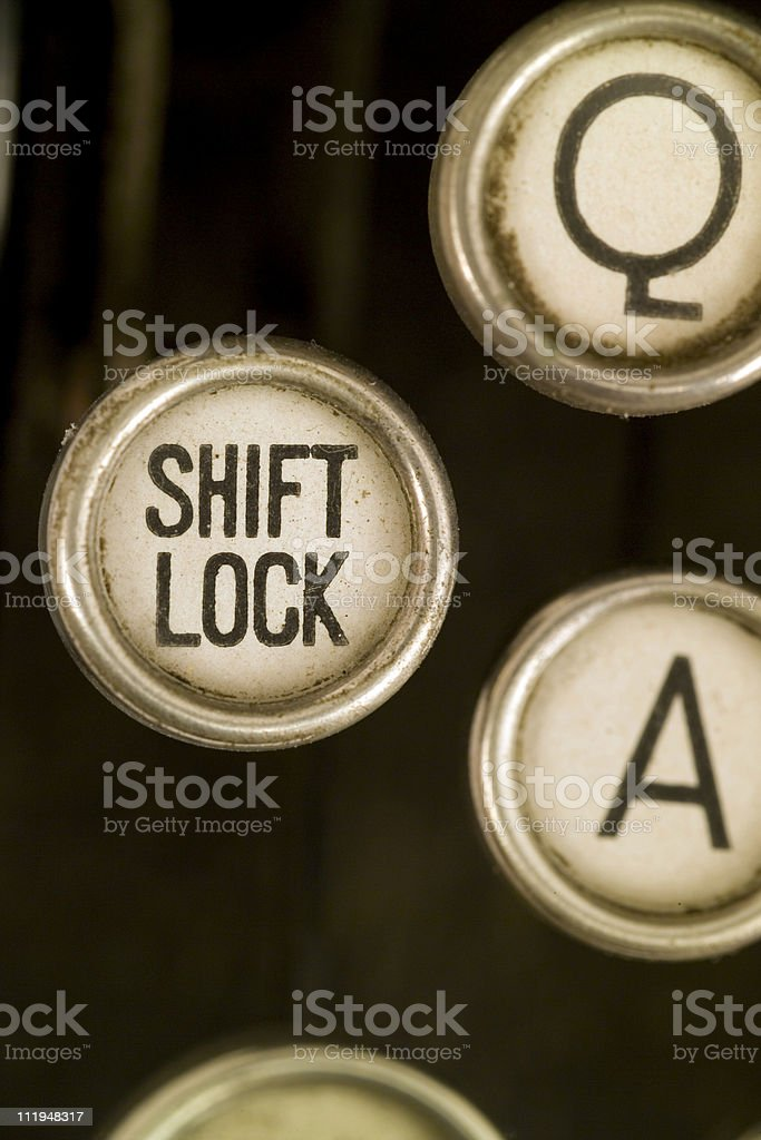 Shift lock on a old typewriter keyboard royalty-free stock photo