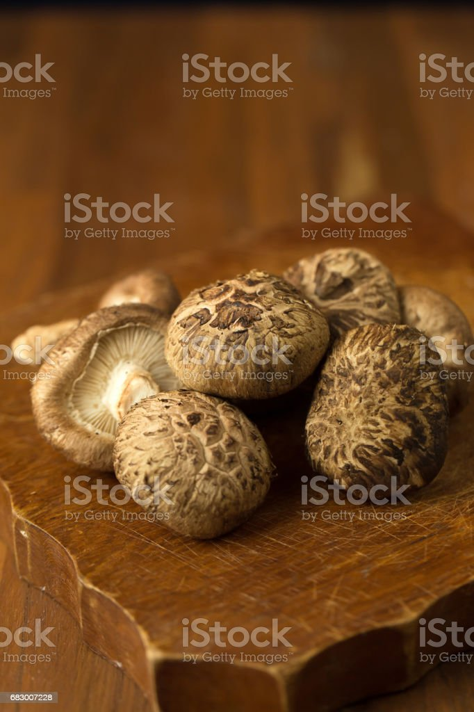 Shiitake mushrooms on a wooden table. Selective focus foto de stock royalty-free