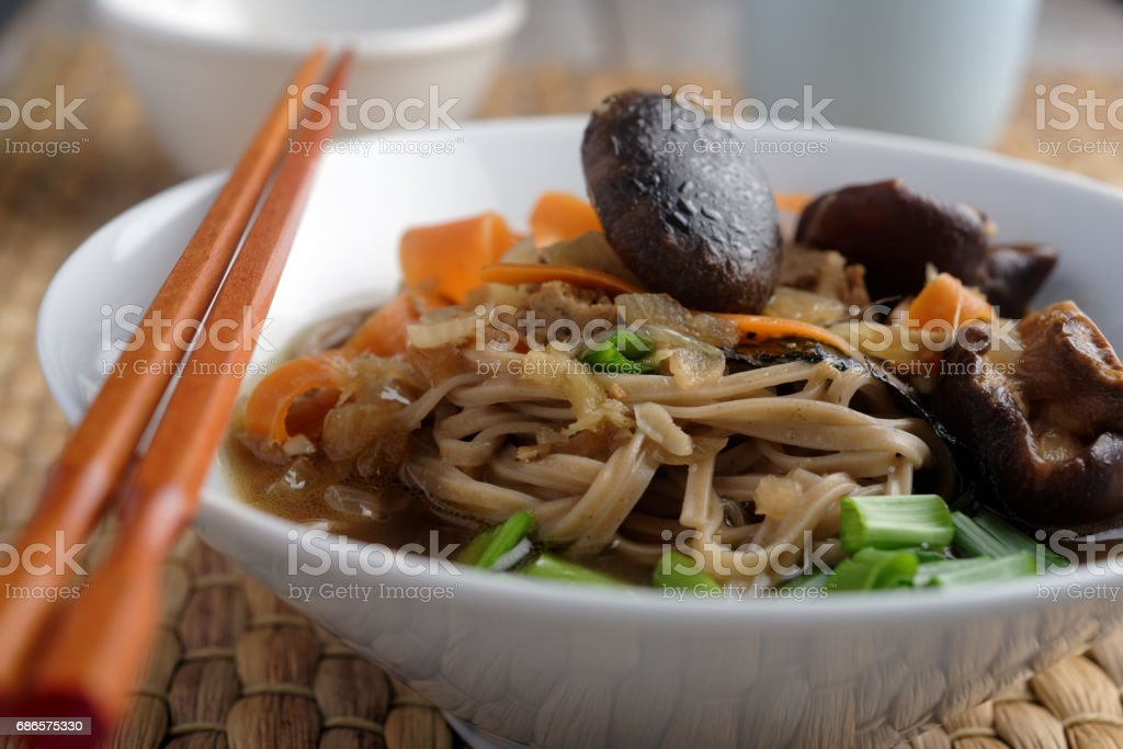 Shiitake, soba, and tofu soup royalty-free stock photo