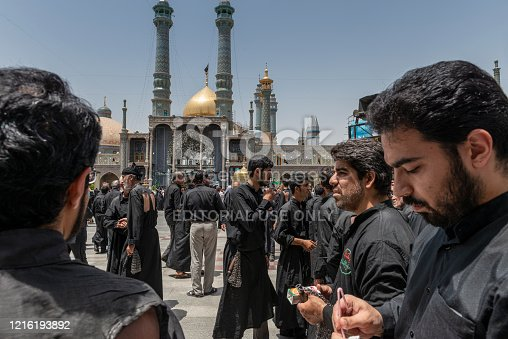 Qom- Iran. -may 14,2013: Shiite muslims practice self-flagellation in the courtyard of the Fatima Masumeh shrine. Fatima Masumeh shrine is an important center of religion for sii sect.