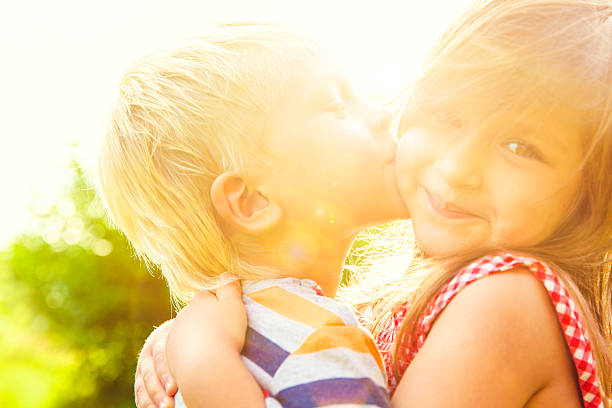 сhildren kissing - little girls little boys kissing love stock photos and pictures