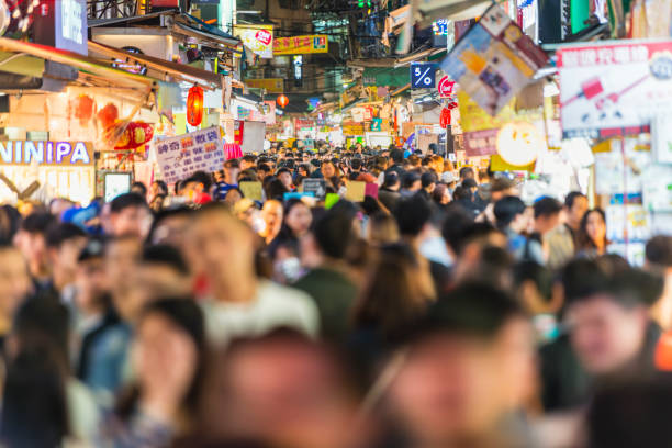 Shilin night market crowds Horizontal color image of the famous Shilin Night Market night market stock pictures, royalty-free photos & images