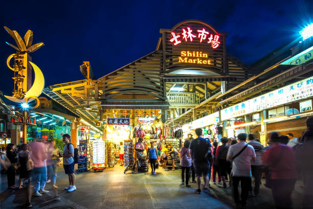 Shilin Night Market in Taipei City. Taipei / Taiwan - Jul 5, 2018: Tourists are shopping in Shilin Night Market. night market stock pictures, royalty-free photos & images