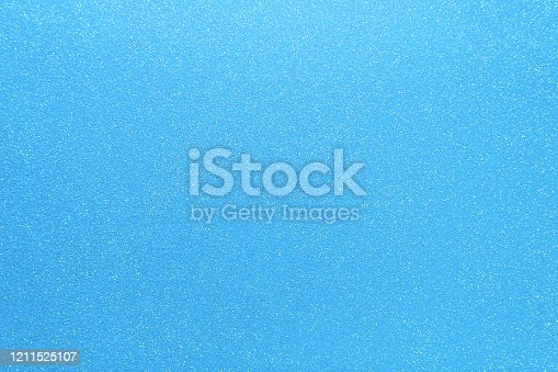 istock Shimmering blue background. Abstract sparkle cloth, pattern. Brilliance texture 1211525107