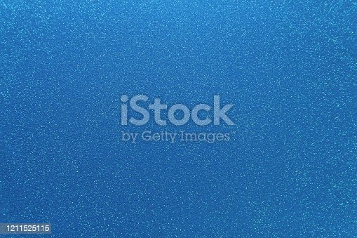 istock Shimmering blue background. Abstract sparkle cloth, pattern. Brilliance texture 1211525115