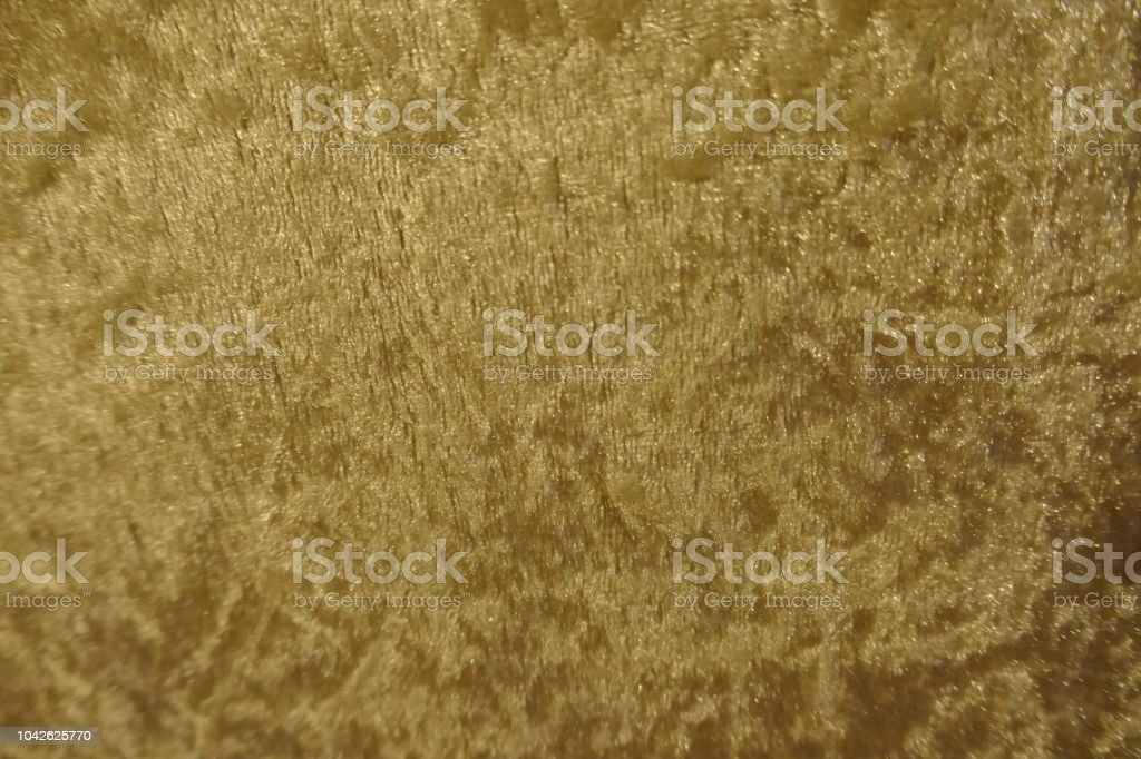 Shimmering golden soft velvet fabric stock photo