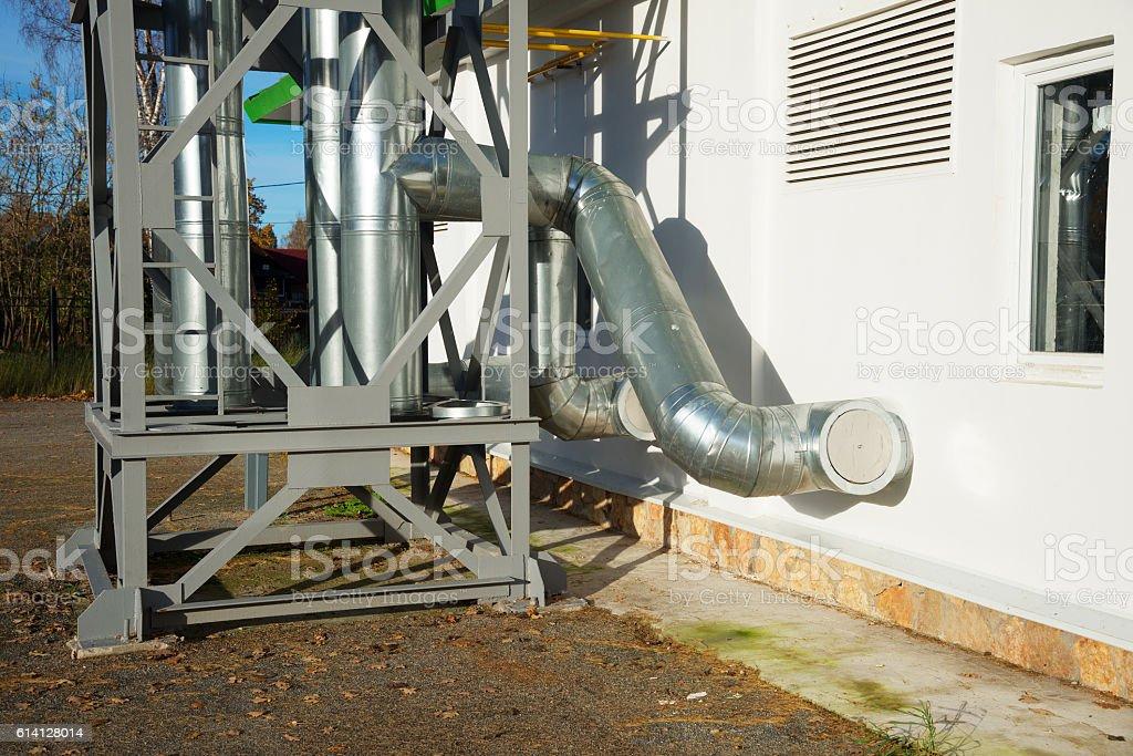 Shine pipeline outside of new boiler Center stock photo