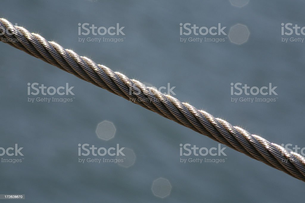 a steel cable against a watery background