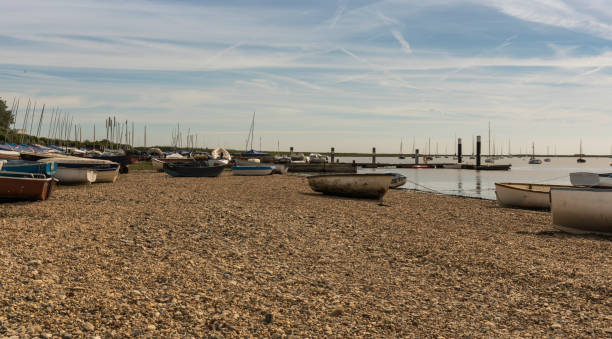 Shingle beach with boats stock photo