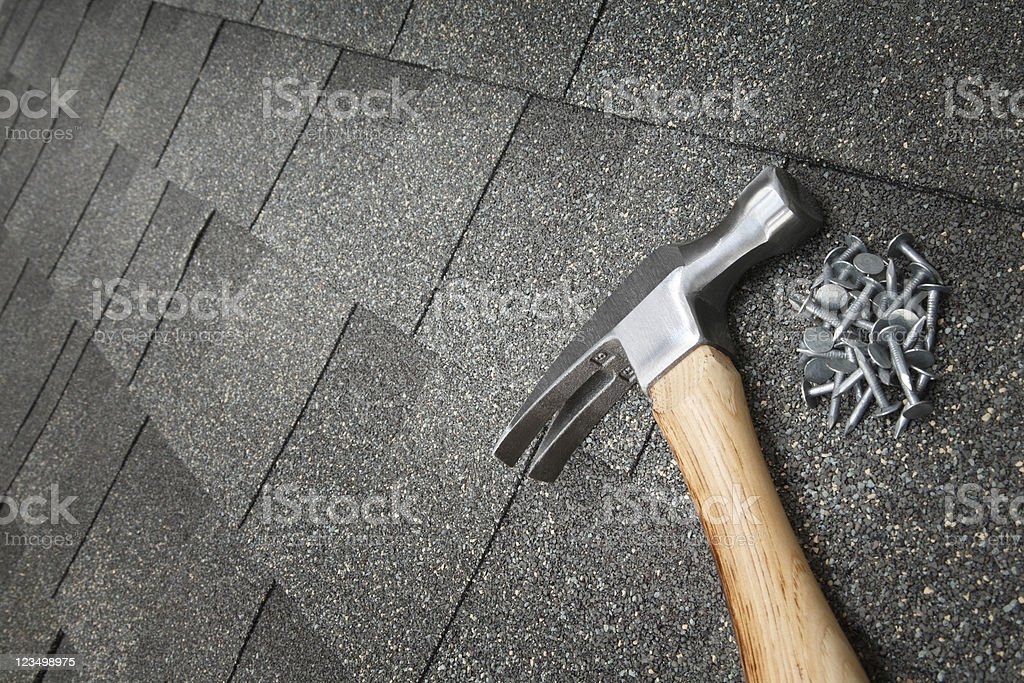 Shingling the Roof stock photo