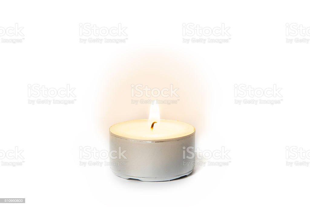 Shining flame on a tea light candle stock photo