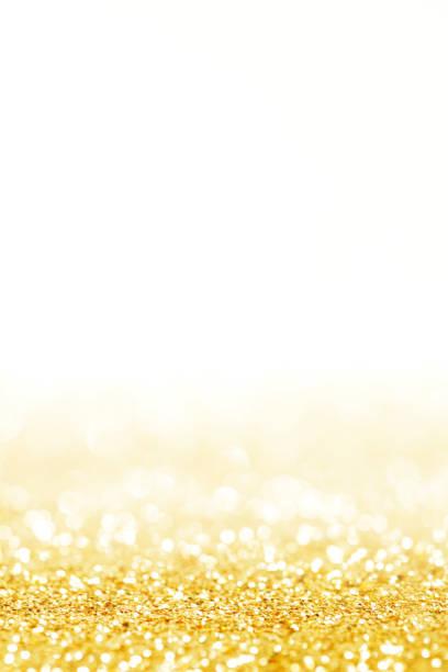 glitter gold urlaub bokeh hintergrund leuchten - goldpailletten stock-fotos und bilder