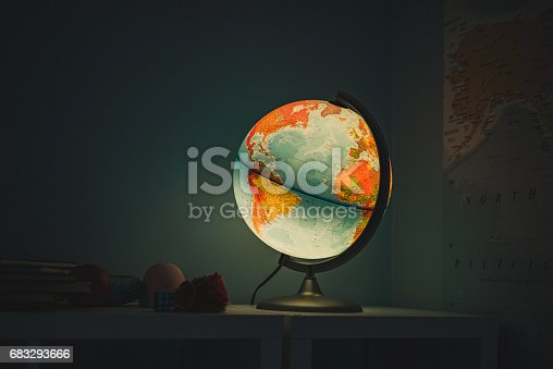 Shining Globe lamp in room planet earth