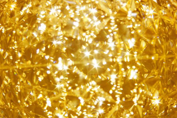 輝く黄金のモザイク ガラスの背景、ゴールデン クリスタルの輝き ストックフォト
