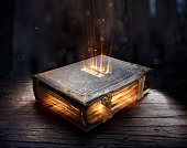 istock Shining Holy Bible - Ancient Book On Old Table 1251957675