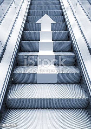 istock Shining metal escalator with white arrow moving up 470932724