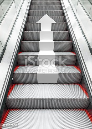 istock Shining modern metal escalator with white arrow 472257850
