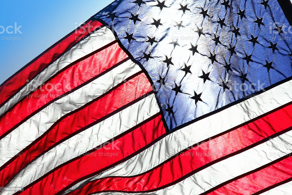 shining sun and  American flag stock photo