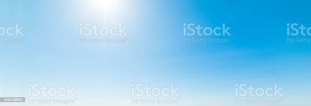 Shining sun and blue sky stock photo