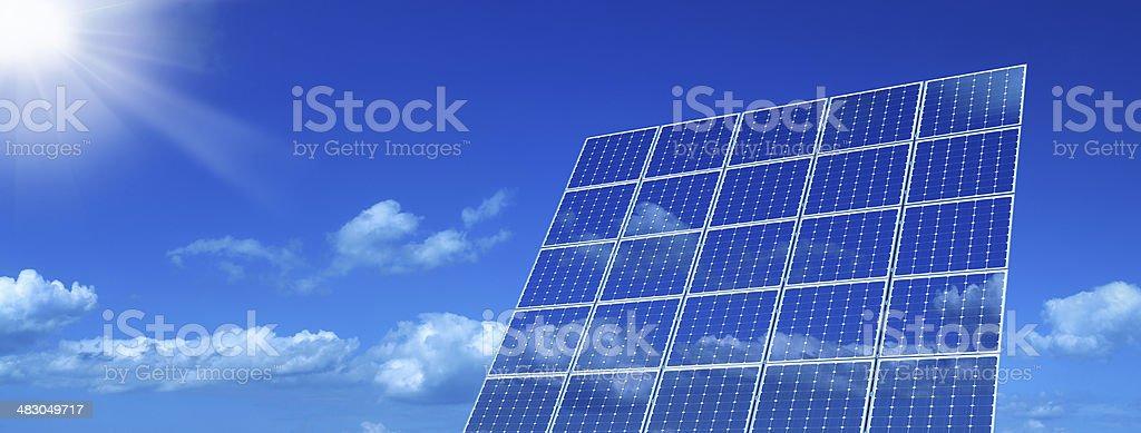 Shining Sun and Solar Panels royalty-free stock photo