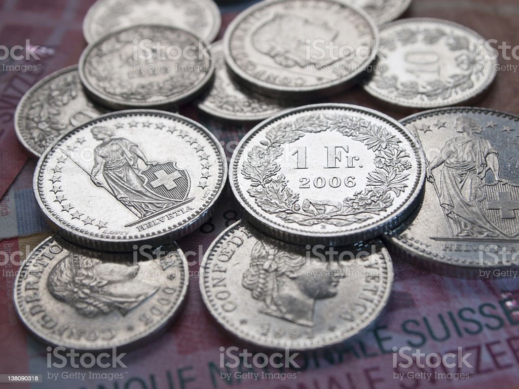 Shining Swiss Franc coins on 20 Swiss Franc bank notes royalty-free stock photo