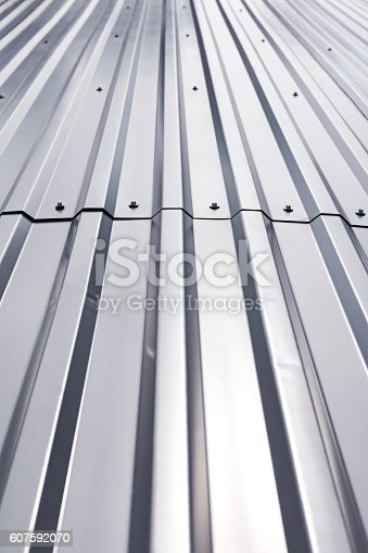 istock shining texture of corrugated industrial metal roof 607592070