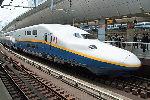 Shinkansen bullet train at railway station Tokyo, Japan - May 17, 2012: Shinkansen bullet train at Tokyo railway station. Shinkansen is world's busiest high-speed railway operated by four Japan Railways companies. electric train stock pictures, royalty-free photos & images