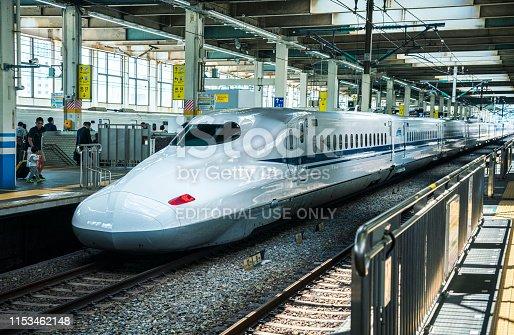 Hiroshima, Japan - March 27, 2019: Shinkansen - japanese bullet train - departing from the railway station in Hiroshima.