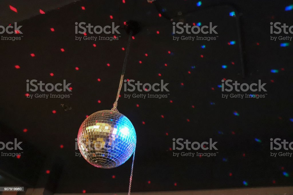 shinning mirror ball hanging on the ceiling (disco ball) stock photo
