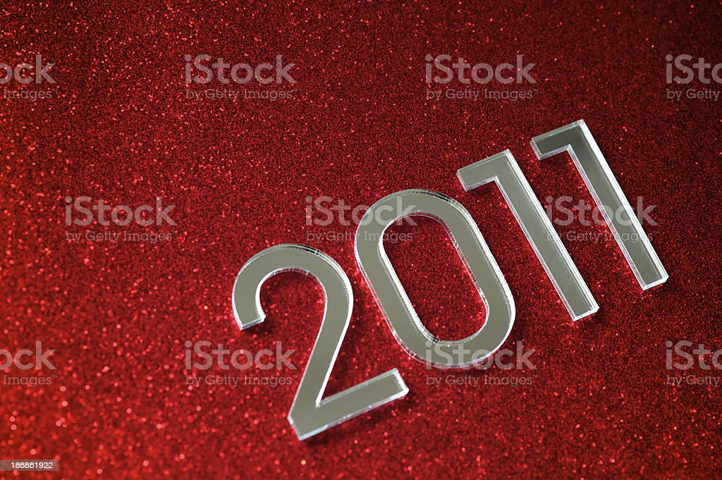 Shiny 2011 Message on Sparkly Red royalty-free stock photo