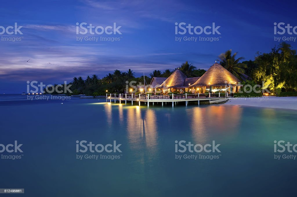 Shiny Beach House At Night Maldives Stock Photo - Download Image Now