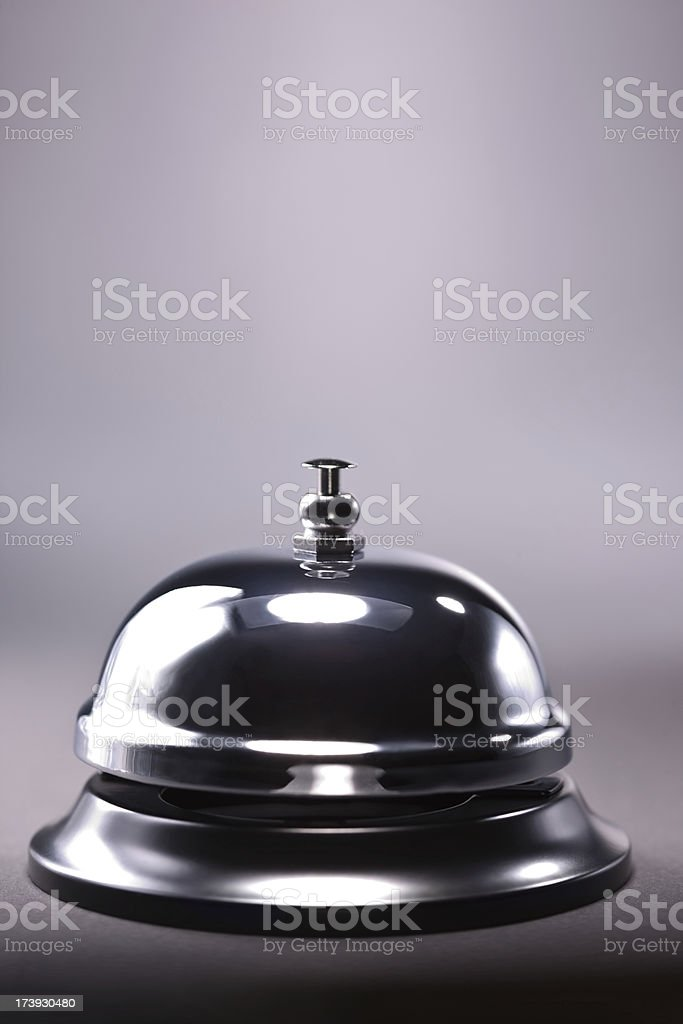 Shiny bell against gray background royalty-free stock photo