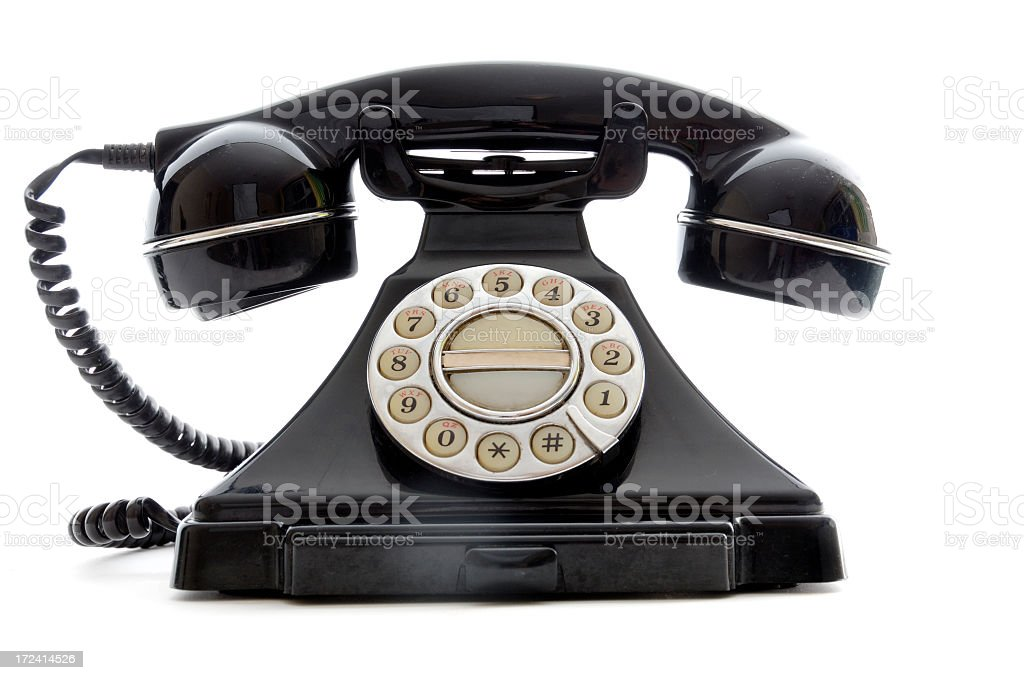 Shiny black retro finger dial telephone on white background royalty-free stock photo
