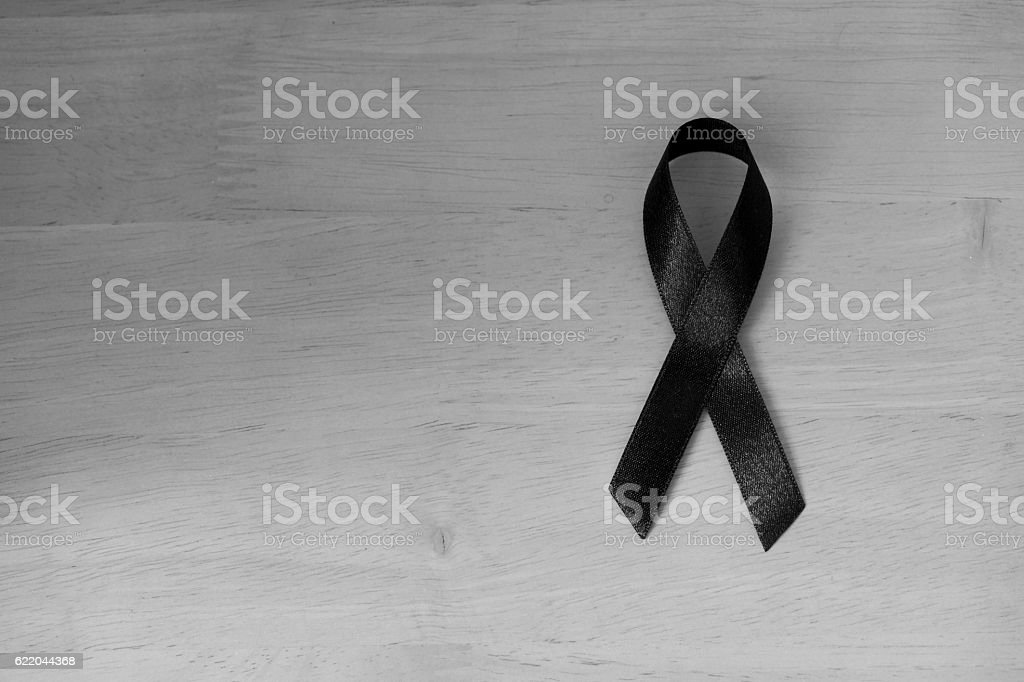 Shiny black ribbon bow fabric texture detail pattern stock photo