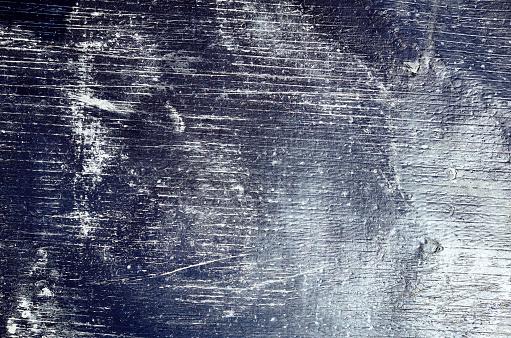Shiny empty black sheet grunge old wall texture background, horizontal white stripes