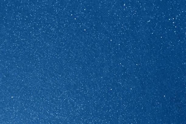 Shiny blue sky glitter background. Christmas abstract background stock photo