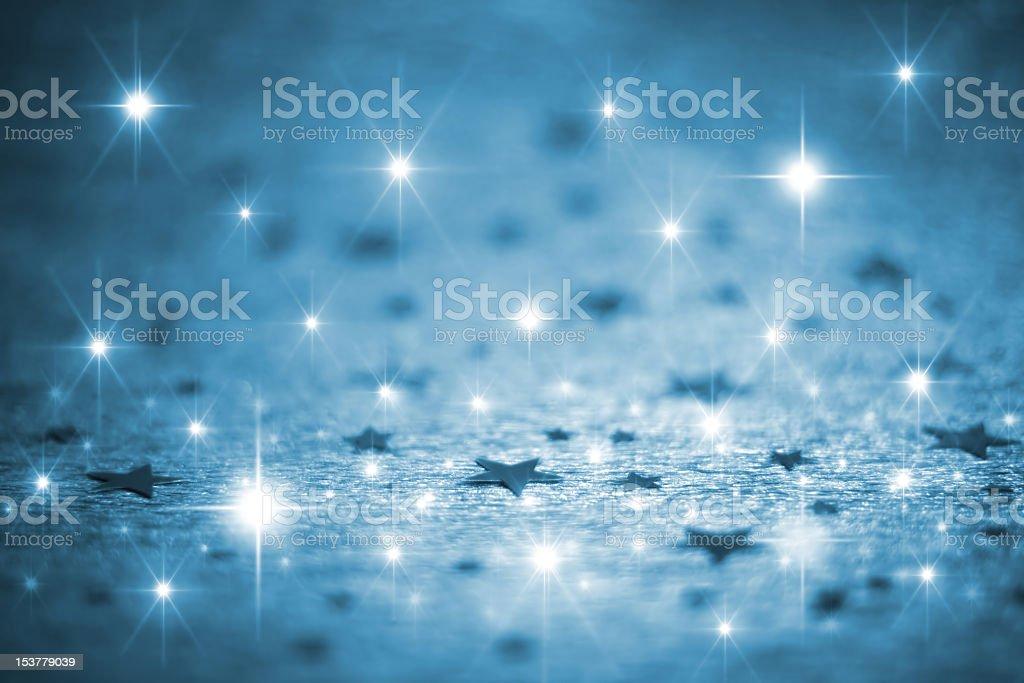 Shiny blue stars and sparkles background royalty-free stock photo