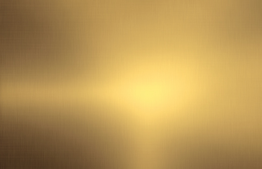 Close up empty shiny brushed gold color metal surface texture