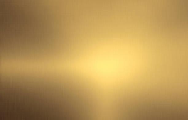 glanzende geborsteld goud kleur metalen achtergrond - messing stockfoto's en -beelden